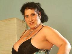 Mature Fatty Doing a Striptease